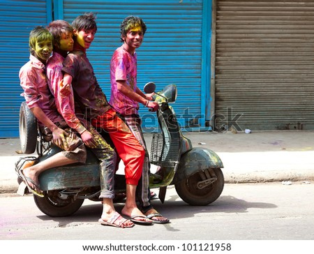DELHI, INDIA - MARCH 08: unidentified People covered in paint on Holi festival, March 08, 2012, Delhi, India. Holi, the festival of colors, marks the arrival of spring, being one of the biggest festivals in India
