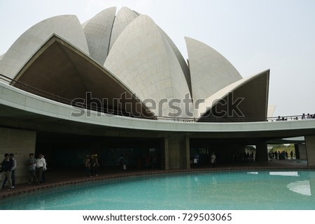 DELHI, INDIA - MAY 12: Tourists visiting Lotus Temple a Bahai house of worship. Mother Temple of Indian. exterior view of famous tourist attraction with marble clad petals on May 12, 2017, North India