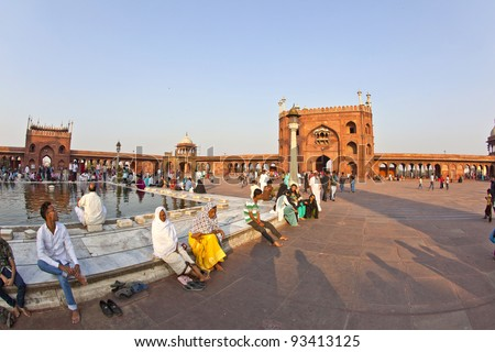 DELHI, INDIA - NOVEMBER 8: A group of worshipers rest on the courtyard of Jama Masjid Mosque in Delhi on November 8,2011. Jama Masjid is the principal mosque of Old Delhi in India.