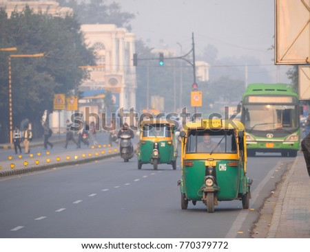 Delhi, India - November 21, 2017: Auto rickshaw traveling on the road. #770379772