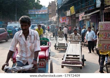 DELHI, INDIA - NOVEMBER 17. Street traders and rickshaws in a crowded street on November 17, 2009 in Delhi, India.