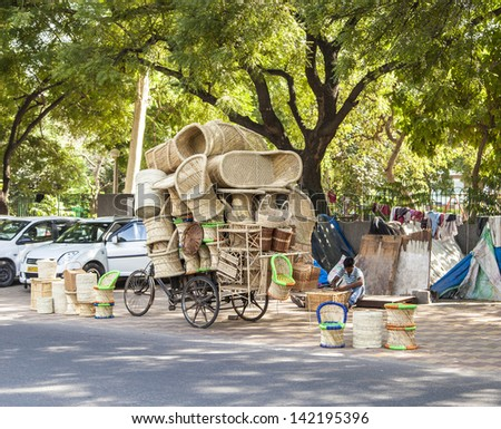 DELHI, INDIA - OCTOBER 14: man sells ratan furniture on October 14,2012 in Delhi, India. Rattan is a cheap natural product from bamboo and used for furniture production in india.