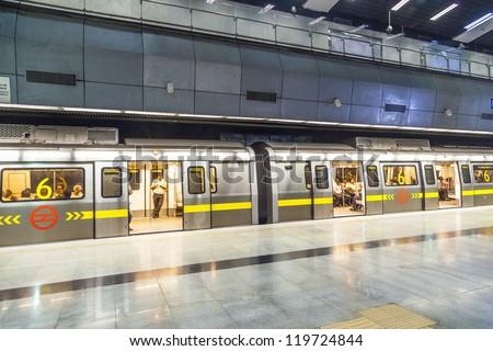 DELHI, INDIA - OCTOBER 16: passengers alighting metro train on October 16, 2012 in Delhi, India. Nealy 1 million passengers use the metro daily.