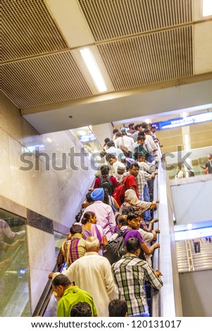DELHI, INDIA - OCTOBER 15: passengers leave the Metro Station Jahangir Puri on October 15, 2012 in Delhi, India. Nealy 1 million passengers use the metro daily.