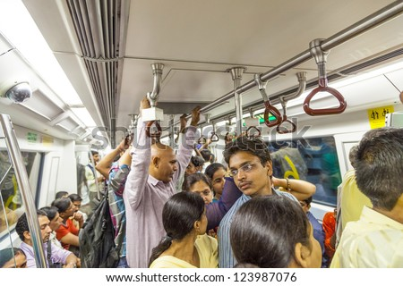 DELHI, INDIA - OCTOBER 16: passengers ride in metro train on October 16, 2012 in Delhi, India. Nealy 1 million passengers use the metro daily.
