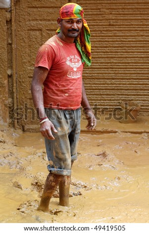 DELHI, INDIA - SEP 19: A hard worker bores a hole to access water on September 19, 2007. Limited water ressources in growing capital cities like Delhi will become increasingly problematic.