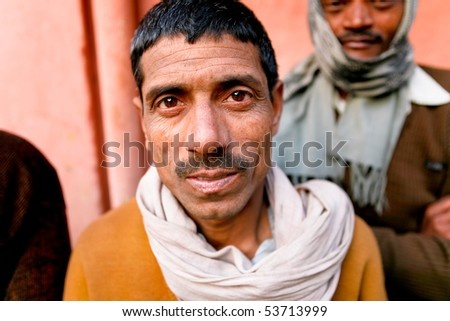 DELHI - JAN 31: Portrait of a day labourer January 31, 2008 in Delhi, India. These men sit on the street hoping to get day jobs not paid more than 2,5 dollars a day.