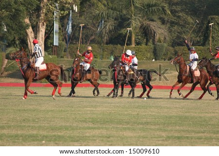 "DELHI - JANUARY 2008: Polo players from the India Army (in red) square off against those from ""Team Kingfisher,"" a private club, during the regular polo season in India."