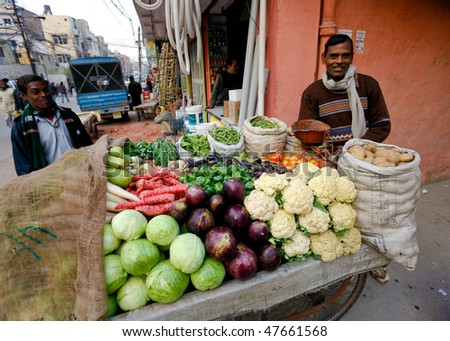 DELHI - JANUARY 31: Vegetable street vendor with his mobile stand on January 31, 2008 in Delhi, India. Most mobile vendors are illegal and have to either run away from the police or pay them bribes.