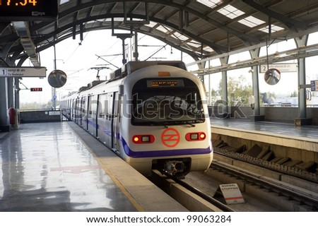 DELHI - MARCH 03: Delhi Metro station on March 03, 2012 in Delhi. Delhi Metro network consists of six lines with a total length of 189.63 kilometres (117.83 mi) with 142 stations - stock photo