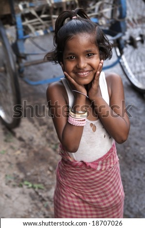 DELHI - MAY 25: Indian street girl smiling. May 25 2006 in Old Delhi, India