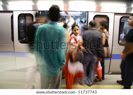 DELHI - SEPTEMBER 17: passengers alighting metro train on September 17, 2007 in Delhi, India. Nealy 1 million passengers use the metro daily.