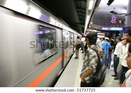 DELHI - SEPTEMBER 17: passengers waiting metro train on September 17, 2007 in Delhi, India. Nearly 1 million passengers use the metro daily.
