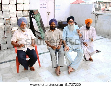 DELHI - SEPTEMBER 22:  Sikh devotees drinking chai at Sis Ganj Gurdwara temple  on September 22, 2007 in Delhi, India. Worldwide there are about 25 million Sikhs.