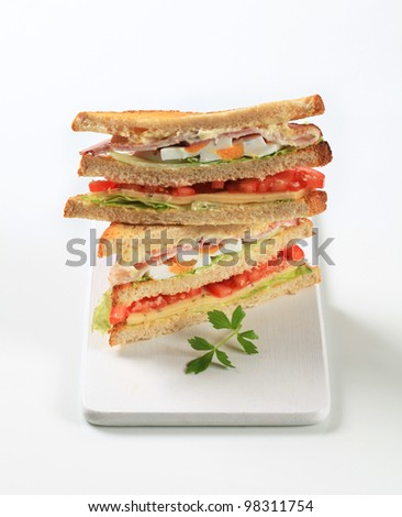 Deli sandwiches with ham, cheese, egg and veggies