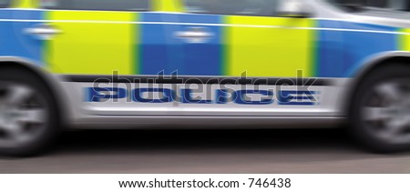 Deliberate blur of speeding police vehicle