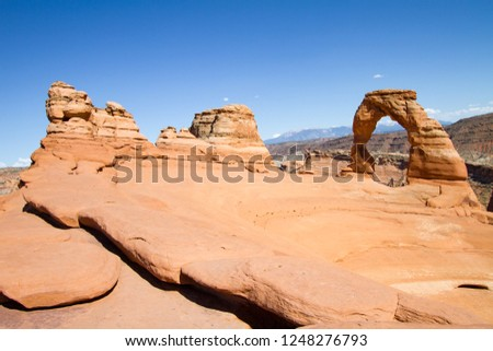 Delicate arch, Arches National Park, Utah, USA.Delicate arch in arches national park with blue sky. Landscape, red rocks and blue sky Arizona. #1248276793