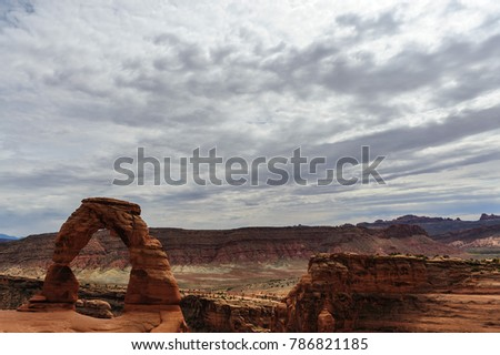 Delicate arch is a key feature, one of the largest stone arches in Arches National Park, Utah, USA. This image is from a slightly cloudy late august afternoon.  #786821185