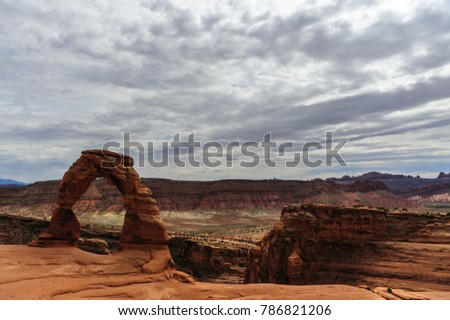 Delicate arch is a key feature, one of the largest stone arches in Arches National Park, Utah, USA. This image is from a slightly cloudy late august afternoon.  #786821206