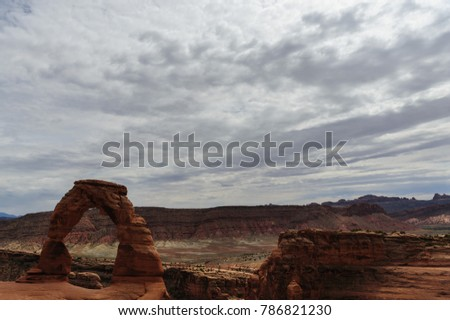 Delicate arch is a key feature, one of the largest stone arches in Arches National Park, Utah, USA. This image is from a slightly cloudy late august afternoon.  #786821230
