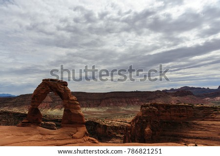 Delicate arch is a key feature, one of the largest stone arches in Arches National Park, Utah, USA. This image is from a slightly cloudy late august afternoon.  #786821251
