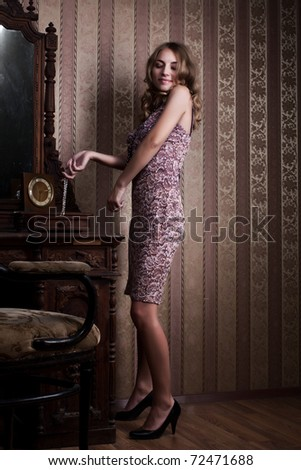 Delicate blond posing in a stylish interior room