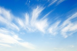 Delicate cirrus clouds in the blue sky