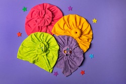Delicate four bright turbans for women, girls or baby. Turban fashion or bandana hair accessories for the beach and travel.