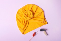 Delicate orange turban for women, girls or baby. Turban fashion or bandana hair accessories for the beach and travel.