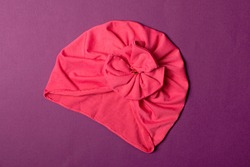 Delicate pink turban for women, girls or baby. Turban fashion or bandana hair accessories for the beach and travel.