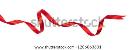 Delicate red wavy ribbon isolated on white background. New Year or Christmas holidays decoration concept.