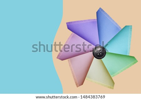 delicate silky cotton fabric folded in triangles of different triangles colors, texture, background, blank for postcard, copy space #1484383769