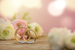 Delicate Wedding background with Rings and Buttercup Flower