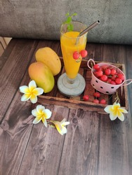 Delicious and creamy Alphonso Mango Smoothie and cherries for breakfast