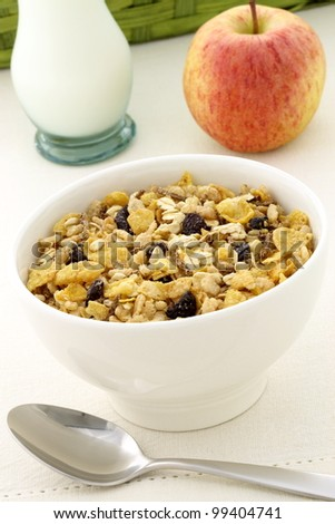 delicious and healthy granola or muesli with a fresh organic apple and lots of dry fruits, nuts and grains.