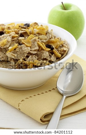 delicious and healthy granola or muesli with fresh organic apple, with lots of dry fruits, nuts and grains.