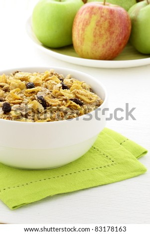 delicious and healthy granola or muesli with fresh organic apples and pears , with lots of dry fruits, nuts and grains.