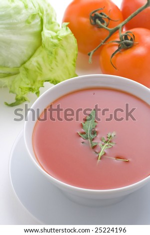 delicious and healthy homemade tomato soup and vegetables isolated