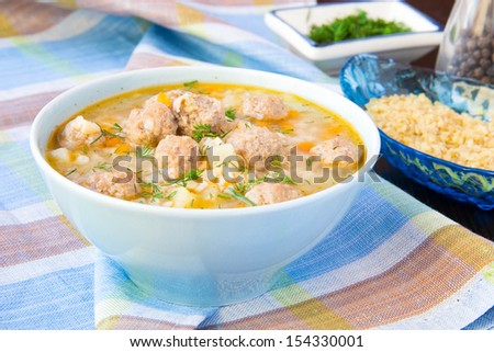 Delicious and healthy hot soup with barley bulgur and small meat balls, warming food