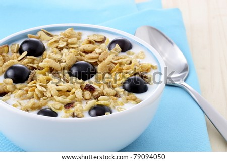 delicious and healthy muesli or granola, with lots of dry and fresh fruits, nuts and grains