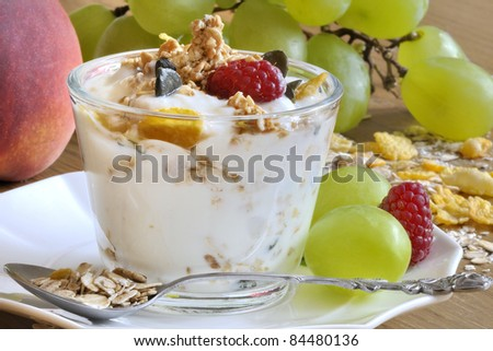 delicious and healthy muesli with yogurt and fruit