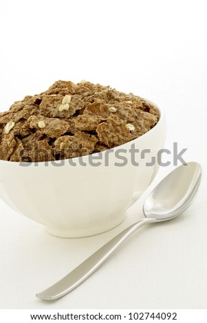 Delicious and nutritious bran flakes cereal, high in bran, high in fiber, served in a beautiful  French Cafe au Lait Bowl with wide rims.  This healthy bran cereal will be an aid to digestive health.