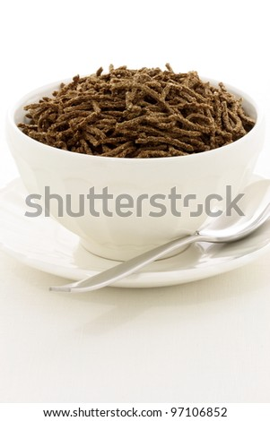 Delicious and nutritious cereal, high in bran, high in fiber, in a beautiful French Cafe au Lait Bowl with wide rims. In place of handles. This healthy bran cereal will be an aid to digestive health.