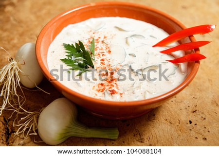 Delicious and refreshing cucumber dish with sour cream and onion.