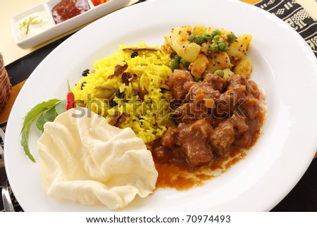 Delicious and spicy Indian beef curry served with pappadums.