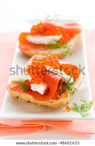 delicious  appetizer with salmon,red caviar and fresh cheese - stock photo