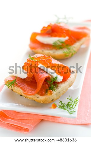 delicious  appetizer with salmon,red caviar and fresh cheese