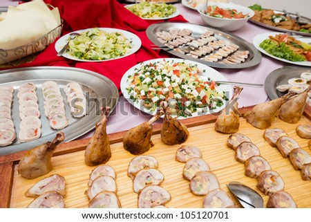 delicious appetizers on platters served at wedding banquet
