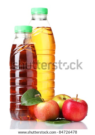 Delicious apple juice in bottles and apples isolated on white