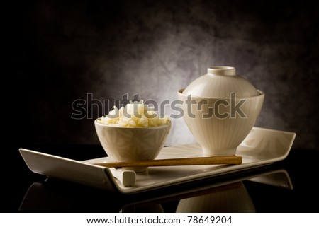 delicious asian rice plate with chopsticks on glass table